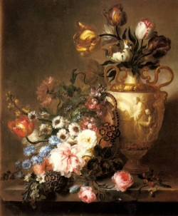 A Still Life With Assorted Flowers In A Basket And Tulips
