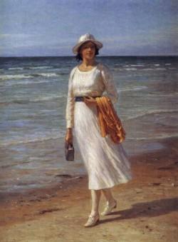 A Lady Walking On A Beach