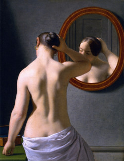 Woman Standing In Front Of A Mirror